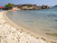Fine sand and shallow crystal waters on the beach Lagonissi in Vourvourou, Chalkidiki