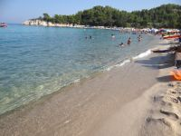 Thick sand and crystal clear waters on the Armenistis beach in Sithonia, Chalkidiki
