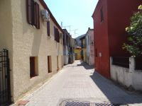 Narrow alley with traditional houses in Sykia, Sithonia, Chalkidiki
