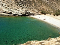 Impressive rocks enclose the beach Livadaki