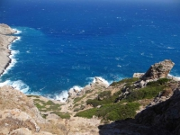 Rocky cliffs and wavy sea in Folegandros