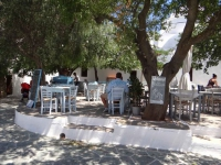 Visitors can find shadow from the trees and good food in Kontarini Square in Chora, Folegandros