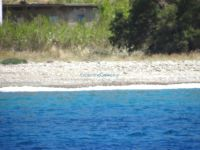 Blue waters, sand and small pebbles on Karavos beach