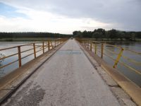The bridge over Strymonas river in the village of Vironeia can fit only one car