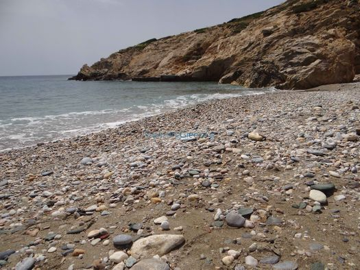 Sand, pebbles and rocks compose the dreamy scene in Malta beach