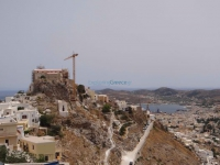 The back side of Ano Syros and in the background  is Hermoupolis