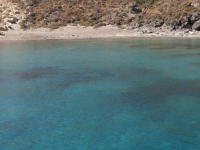 Crystal clear waters on the beach Grammata in north Syros