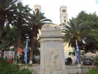 In front of Agios Nikolaos, the square with palm trees